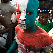 A Convention People's Party (CPP) with his body painted in the colors of the party is seen during a rally in Accra, Ghana on Sunday September 21, 2008.