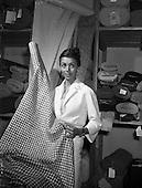 1959 - Actress Dana Wynter selecting tweeds at Gaeltarra Eireann
