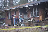 Investigators were on the scene of a house fire on 1109 South 14th Street in Oxford, Miss., on Thursday, January 20, 2011. The fire, reported about 12:30 a.m., claimed the life of Patricia K. Wilkerson.
