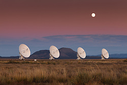 Moonrise over the Very Large Array (VLA). The Plains of San Augustin, New Mexico.