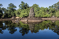 "Neak Pean ""The entwined serpents"" is built on an artificial island with a Buddhist temple on a circular island and was constructed during the reign of King Jayavarman VII.  The temple and lake represent Anavatapta - a mythical lake in the Himalayas - with waters that are believe to cure illnesses. Neak Pean was set up for medical purposes.  The ancients believed that going into the pools would cure diseases based on the ancient Hindu belief of balance. Four connected pools represent Water, Earth, Fire and Wind. The stone statues in pavilions are meant to represent the heads of the Four Great Animals."