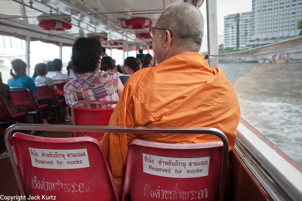 Mar 25, 2009 -- BANGKOK, THAILAND: A Buddhist monk rides on a Chao Phraya River ferry boat along the Bangkok waterfront. The Chao Phraya River is a major transportation artery in Bangkok. Photo by Jack Kurtz