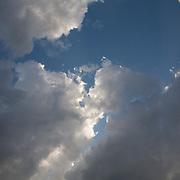 Billowing clouds against blue sky, Yorktown, Virginia