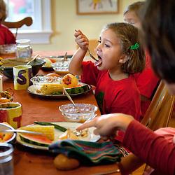 The Mount family eat dinner on their farm in Princeton, N.J., Sept. 17, 2011.