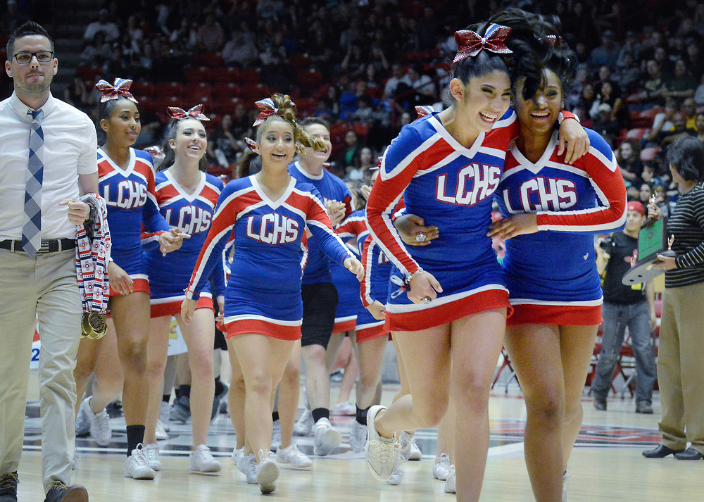 Las Cruces cheerleaders celebrate their Class 6A championship win during the State Spirit Championships at The Pit in Albuquerque, N.M., Saturday, March 25, 2017. (Marla Brose/Albuquerque Journal)