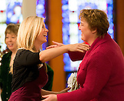 Professor Kaye Slater reaches forward to congratulate new graduate Carla Ballensky in 2013. (Photo by Ryan Sullivan)