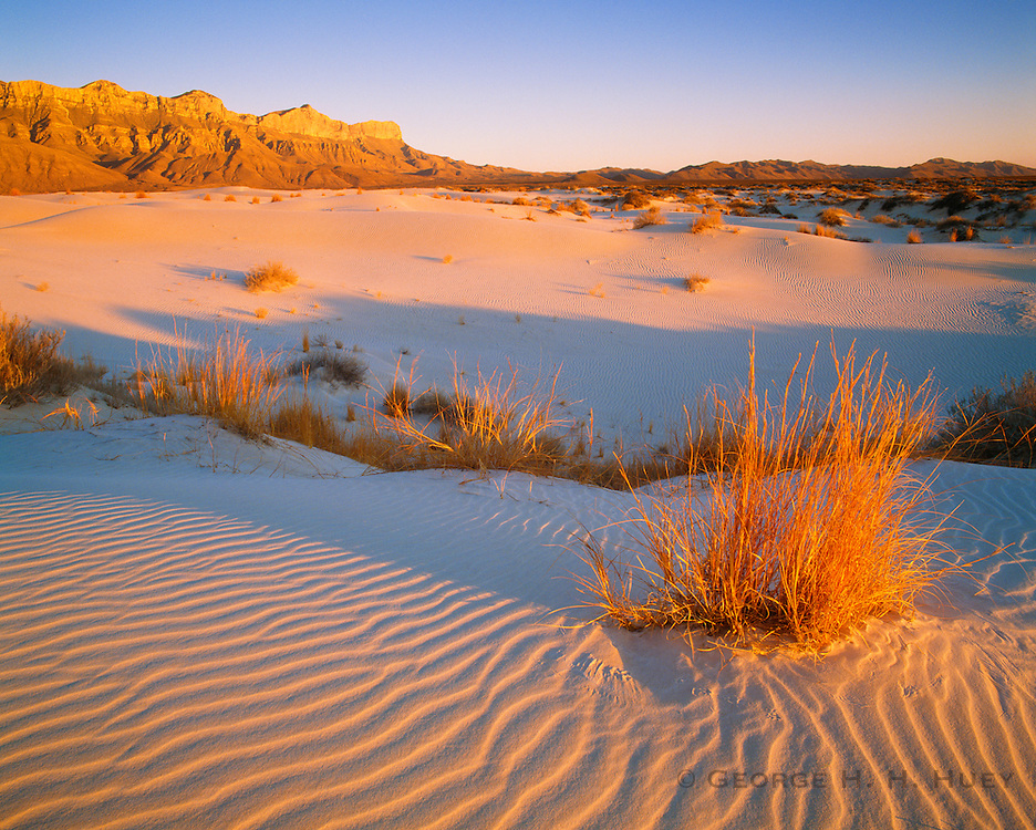 0504-1021 ~ Copyright:  George H. H. Huey ~ Gypsum dunes with the Guadalupe Mountains in distance, sunset.   Guadalupe Mountains National Park, Texas.