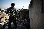 SYRIA - Al Qsair. A Free Syrian Army fighter inspect a former Al Asad Forces position in the outskirts of Al Qsair, on February 24, 2012. ALESSIO ROMENZI