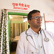 CAPTION: Dr Ram Chandra Soren is the area's Medical Officer-in-Charge. He oversees the ARSH clinic here. He says that they've seen a lot of changes since the clinic opened. At first there were around 20 clients; this has grown to approximately 250. Though he studied and started his career in Orissa, Dr Ram is originally from this community and this gives him a great level of acceptance among the community members, which makes it very easy for him to communicate with them. People also know that he's approachable outside of the regular office hours. LOCATION: Adolescent Reproductive and Sexual Health (ARSH) clinic, Ghatshila Community Health Centre (CHC), Purbi Singhbhum (district), Jharkhand (state), India. INDIVIDUAL(S) PHOTOGRAPHED: Dr Ram Chandra Soren.
