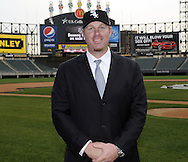 CHICAGO - DECEMBER 03:  Adam Dunn of the Chicago White Sox poses for a photo on the field after a press conference announcing his free agent signing with on December 3, 2010 at U.S. Cellular Field in Chicago, Illinois.  (Photo by Ron Vesely)