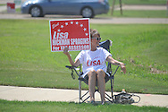 Lisa Spragins, candidate for tax assessor of Lafayette County, holds a sign as she campaigns outside the polls at the Oxford Conference Center in Oxford, Miss. on Tuesday, August 23, 2011.