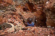 19 January 2008, Kolwezi, DRC. Diggers, the local term used for informal, sometimes illegal miners, dig in discarded mine dumps for cobalt, copper and other minerals. Some of this they sell back to the mining company that holds the concession, or to Chinese traders. Desperation forces them to dig as deep as 20 metres under the surface. There are several deaths a year from tunnels collapsing on these brave men.