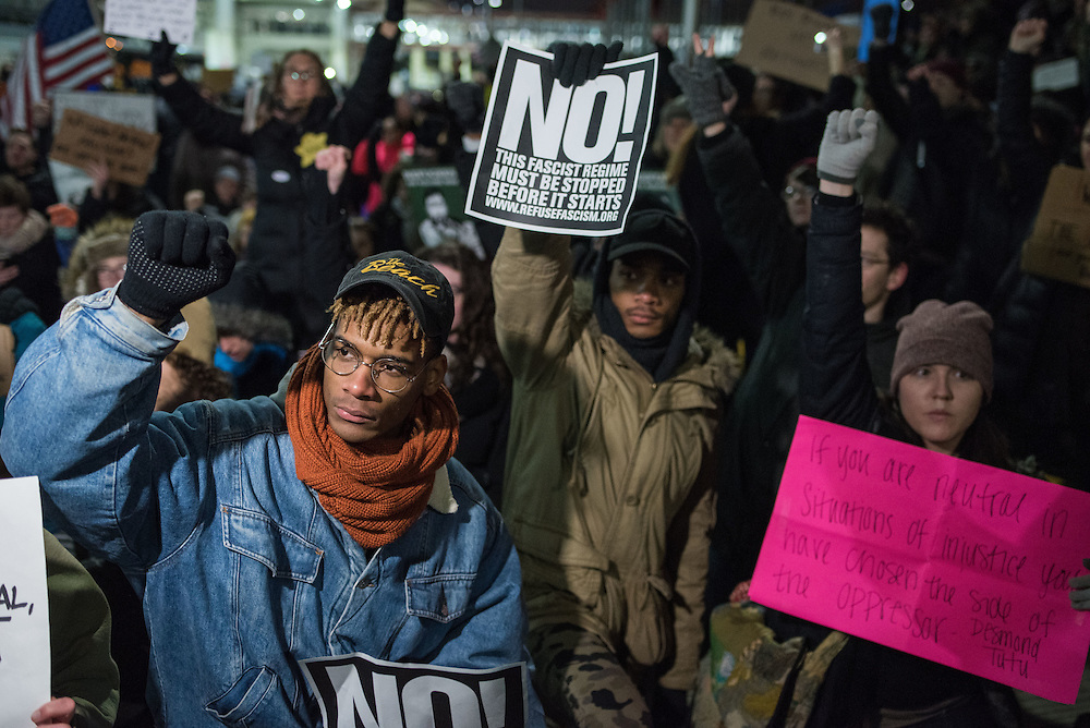 Thousands fill the street outside Terminal 5 of O'Hare International Airport in protest of President Trump's order to ban refugees and citizens from select Muslim countries.