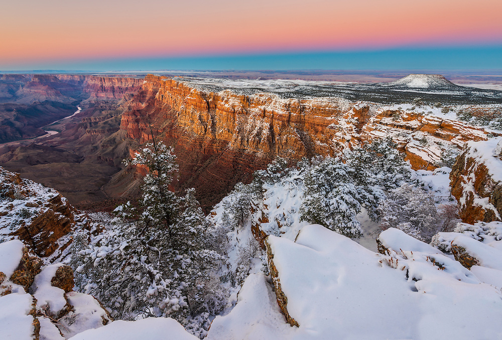 Earth Shadow rises above the a winter scene at Grand Canyon National Park in Arizona.