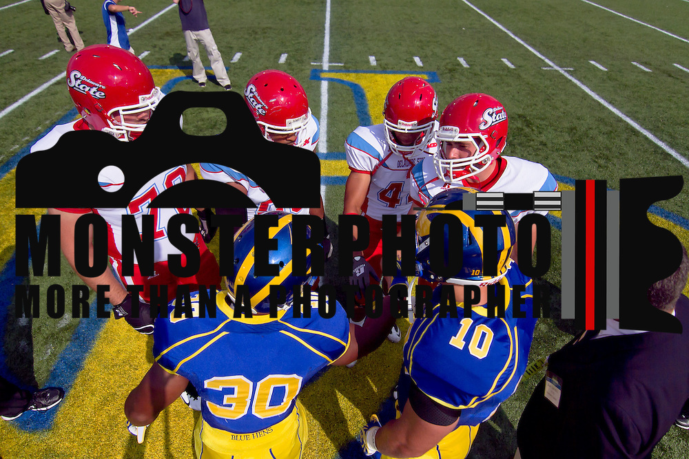 Delaware Captains Andrew Pierce (30) and Delaware Linebacker Paul Worrilow (10) shake hands with Delaware State Captains prior to a Week 2 NCAA football game at Delaware.