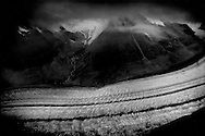 A river of razor sharp crevasses: The Great Aletsch Glacier, the Alps' longest glacier at 22.6 km (14 miles) in length passes by a valley where the Mittlealetsch (Middle Aletsch) Glacier, seen descending high up in the opposite valley, used to meet the Great Aletsch Glacier but now the two glaciers do not come close to meeting and the distance between them is growing with global warming.  There are photographs from the late 19th century where the two rivers of ice can be clearly seen meeting.  By the end of the 21st century, scientists believe the glaciers will lose 80% of their current mass.