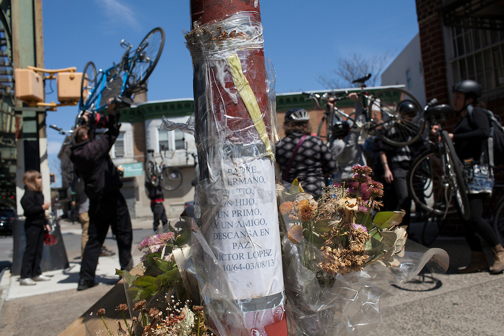 Families and friends of New Yorkers killed while bicycling on New York City streets gather at the Ghost Bike memorial for Victor Lopez at the corner of Utrecht Ave. and 58th St. in Brooklyn, NY, on Sunday, April 21, 2013 as they participate in the 8th Annual Ghost Bike Memorial Ride. The ride visited the 20 white-painted Ghost Bikes installed at the scene of bicyclist fatalities in five boroughs before converging at the intersection of Queens Boulevard and Jackson Avenue to dedicate a memorial to all of the cyclists who were killed in traffic crashes in 2012 whose deaths did not make the news...According to the New York City Department of Transportation, 136 pedestrians and 18 bicyclists were killed in 2012. In 2011, 134 pedestrians and 22 bicyclists were killed on New York City streets. To date, at least two bicyclists have been killed in 2013...Photograph by Andrew Hinderaker for the Ghost Bike Project.
