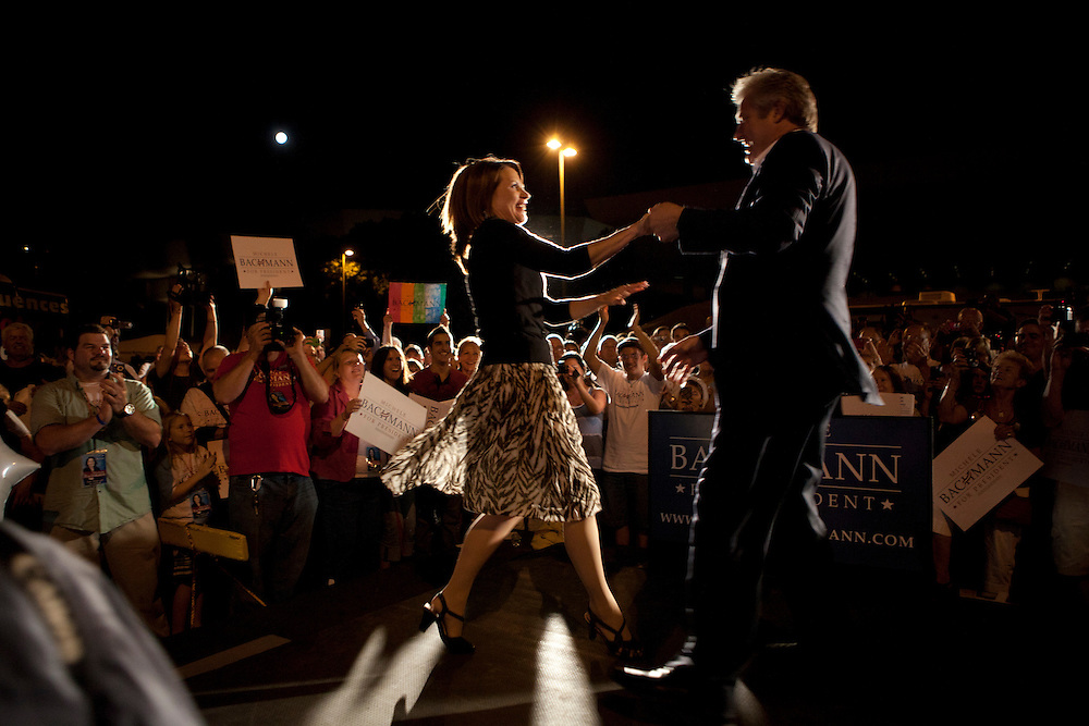 Republican presidential hopeful Michele Bachmann dances with her husband Marcus Bachmann during a campaign stop on Friday, August 12, 2011 in Ames, IA.