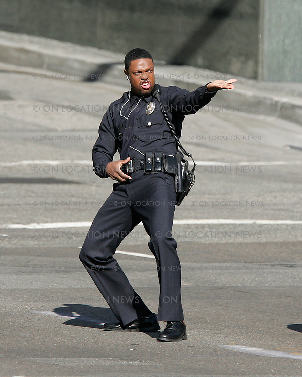 Febuary 3, 2007 Los Angeles, CA. Chris Tucker Films a funny scene for Rush Hour 3. His character is directing traffic as he sings and dances creating cars to start crashing in to each other. Non Exclusive Photo By Eric Ford / On Location News Tel: (818) 613-3955  EMail: info@onlocationnews.com