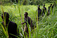 Boys and men who are part of the Arrow boys patrol their village after an LRA attack. The Arrow boys have since become a legitimate militia called the home guard and took it upon  themselves to violently drive out a group of pastorlists in their state.