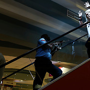 A police officer secures an area as civilians flee inside Westgate Shopping Centre.