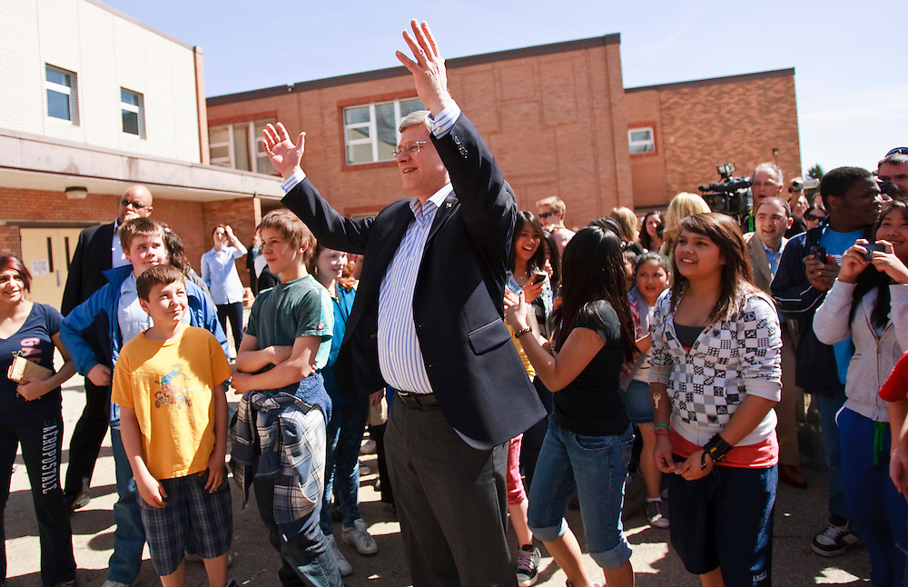 Conservative leader Prime Minister Stephen Harper greets students at St. Augustine Catholic school in Calgary, Alberta where he was voting in Canada's 41st federal election May 2, 2011.<br /> AFP/GEOFF ROBINS/STR