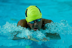 Swimmer recovers during breaststroke at the Enchanted Forest swim meet held at Forest Park, Noblesville, Indiana.