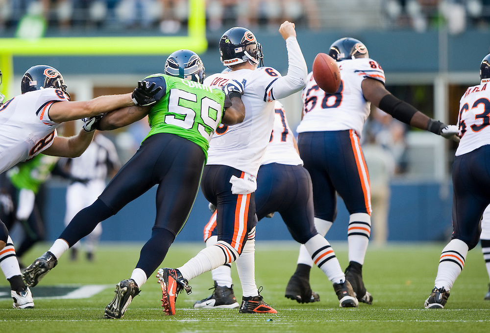 SEATTLE SEAHAWKS VS CHICAGO BEARS - Seattle's Aaron Curry hits and forces Chicago's Jay Cutler to fumble in the second half.