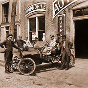 Vintage Photo: Hupmobile auto dealer, circa 1910.  Man driving has his dog and an older man riding in the auto. New car Sales