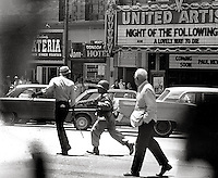 Youth being chased through city center during People's Park Student protest & riots in Berkeley California 1969