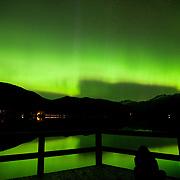 People watch a rare southern Northern Lights, or Aurora Borealis, display along the shore of Whistler's Green Lake.  Sunday, May 28, 2017.<br /> <br /> Photo:  David Buzzard