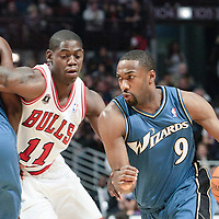 13 November 2010: Washington Wizards' point guard #9 Gilbert Arenas drives past Chicago Bulls' shooting guard #11 Ronnie Brewer during the Chicago Bulls 103-96 victory over the Washington Wizards at the United Center, in Chicago, Illinois, USA.
