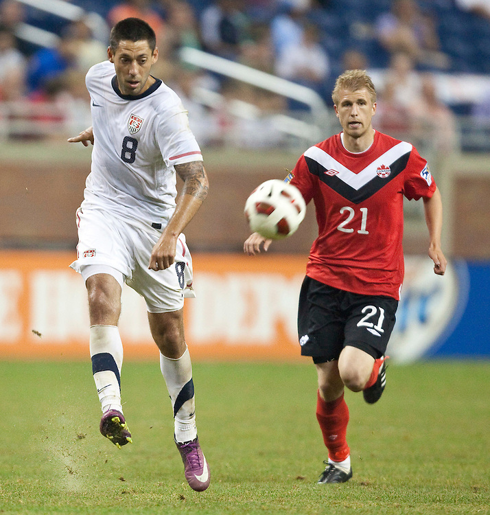 GR8015 -20110607- Detroit, Michigan,USA<br /> Clint Dempsey of the United States keeps the ball from Canada's Jonathan Beaulieu-Bourgault during their CONCACAF match at Ford Field in Detroit Michigan, June 7, 2011.The United States won 2-0.<br /> AFP PHOTO/Geoff Robins