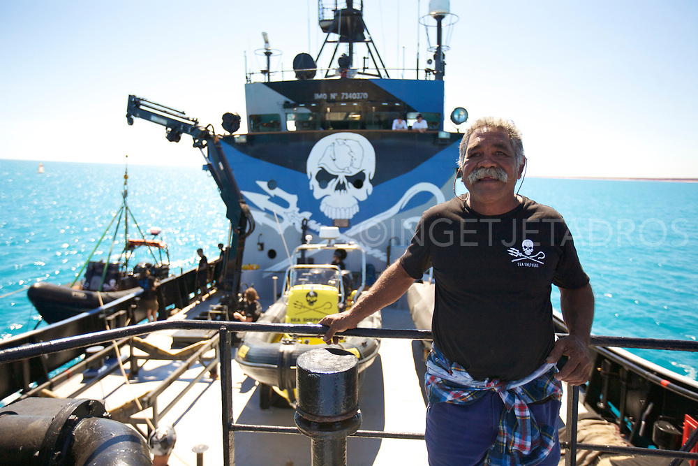 Ron Roe, Goolarabooloo man, standing on the deck of the Seashepherd's Vessel 'Steve Irwin.' Worried about the sacred sites as Woodside prepares to destroy burial sites and ancient culture for gas in the Kimberley – Operation Kimberley Miinimbi. Broome, WA