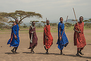 Maasai men dance for visitors.