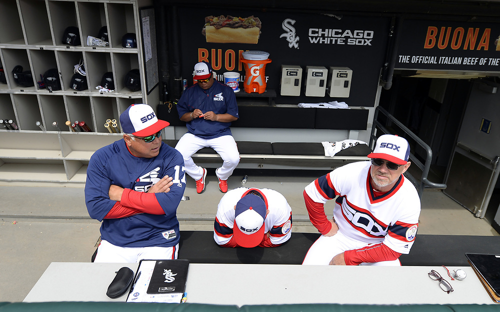 CHICAGO - APRIL 09:  Manager Rick Renteria #17 of the Chicago White Sox and his staff look on prior to the game against the Minnesota Twins on April 9, 2017 at Guaranteed Rate Field in Chicago, Illinois.  (Photo by Ron Vesely)   Subject:  Rick Renteria