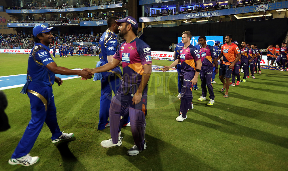 Mumbai Indians and Rising Pune Supergiants players shakes hand after the match 1 of the Vivo Indian Premier League ( IPL ) 2016 between the Mumbai Indians and the Rising Pune Supergiants held at the Wankhede Stadium in Mumbai on the 9th April 2016<br /> <br /> Photo by Sandeep Shetty/ IPL/ SPORTZPICS