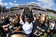 "Army players reach to touch the plaque bearing a quote from General George Marshall on the field prior to their game against Stanford in Michie Stadium at the United States Military Academy in West Point, NY on Saturday, September 14, 2013. The plaque reads, ""I want An Officer For A Secret And Dangerous Mission. I Want A West Point Football Player.""  Stanford defeated Army 34 - 20."