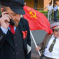 RUSSIA - Russland - MOSCOW, MOSKAU - Platz der Revolution: Schauspieler als LENIN mit Handy;. Revolution Square, actor as LENIN with mobile phone & Brezhnev  with Soviet flag