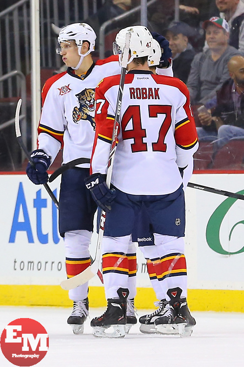 Mar 31, 2014; Newark, NJ, USA; The Florida Panthers celebrate a goal by Florida Panthers defenseman Dmitry Kulikov (7) during the first period at Prudential Center.