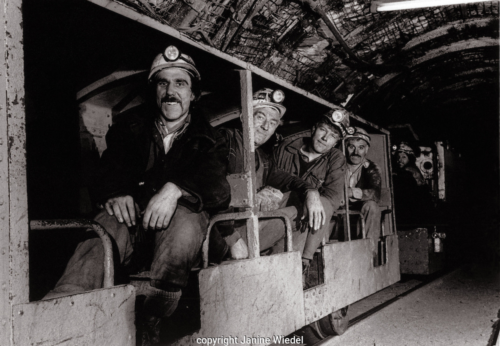 Train transporting miners  down into the mine shaft to the face Florence Colliery Stoke on Trent  Staffordshire. 1970's