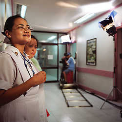 A soap opera depicting Overseas Filipino Worker, OFW, life is filmed inside a hospital in Manila, Philippines on Dec. 2006. OFW life is permeates pop culture in the Philippines with popular singers and television programs among other things, targeting families and workers. In this particular program, an OFW visits the hospital after learning that he has contracted HIV from being promiscuous while abroad. He later finds out that he may have infected his pregnant wife.