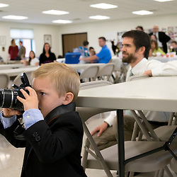 30 APRIL 2016 -- WENTZVILLE, Mo. -- Noah Woodrome (front left), 5, son of Brandon and Lisa Woodrome of Mascoutah, Ill., photographs Gianna Emanuela Molla (not pictured), daughter of St. Gianna Beretta Molla, during a reception following Mass at St. Gianna Catholic Church in Wentzville, Mo. Saturday, April 30, 2016. The event honored the visit of Molla and marked the 10th anniversary of the founding of St. Gianna Parish.<br /> <br /> Photo by Sid Hastings.