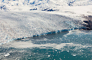 Aerial of face of the east branch of the Columbia Glacier in Prince William Sound in Southcentral Alaska. Spring. Moring.