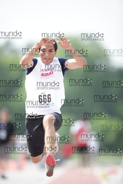 (London, Ontario}---04 June 2010) Bunny Bassan of Father Redmond - Toronto competing in the senior boys triple jump at the 2010 OFSAA Ontario High School Track and Field Championships. Photograph copyright Geoff Robins / Mundo Sport Images, 2010.
