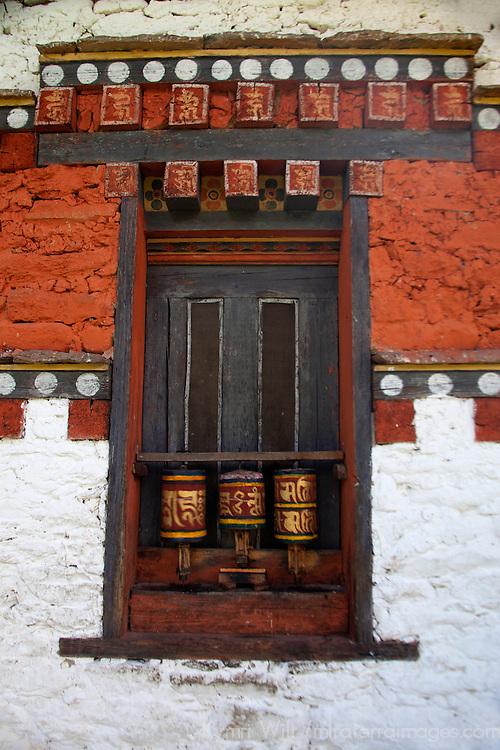 Asia, Bhutan, Bumthang. Prayer wheels at Jambay Lhakhang, a Buddhist temple dating back to the 7th century.