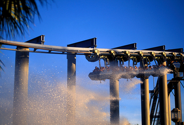 Stock photo of the XLR8 roller coaster at AstroWorld with spray from the log ride.