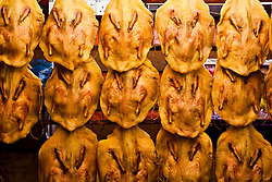 Dried chickens hanging in a restaurant in the center of Kuala Lumpur, Malaysia, Southeast Asia