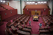 Australian Parliment House Canberra. Tam Thi Duong (shorter) and Chanmala Souksavat (taller) cleaners vacuum the gallery of the Senate.
