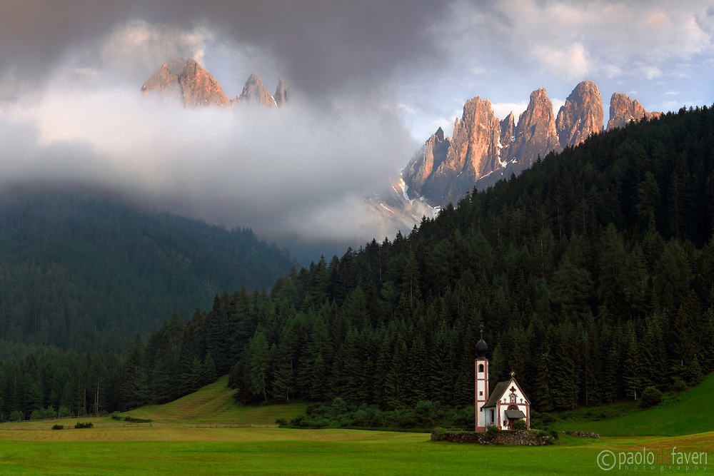 A classic view of the Odle range, an amazing dolomitic massif placed at the top of Val di Funes/Vilnosstal in Alto Adige/South Tyrol in Italy, with the small, wonderful chappel of Saint Johann in the foreground. It had be rainy and overcast most of the day, but the sky cleared off right in time for sunset, contributing a unique drama and mood to this stunning scenery.